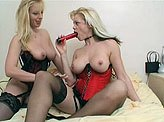 Busty blonde lesbians using tongues and sex toys