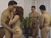 Sex Video 600 :: Woman takes on 3 hard cocks at once